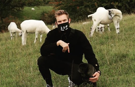pewdiepie in field with dog