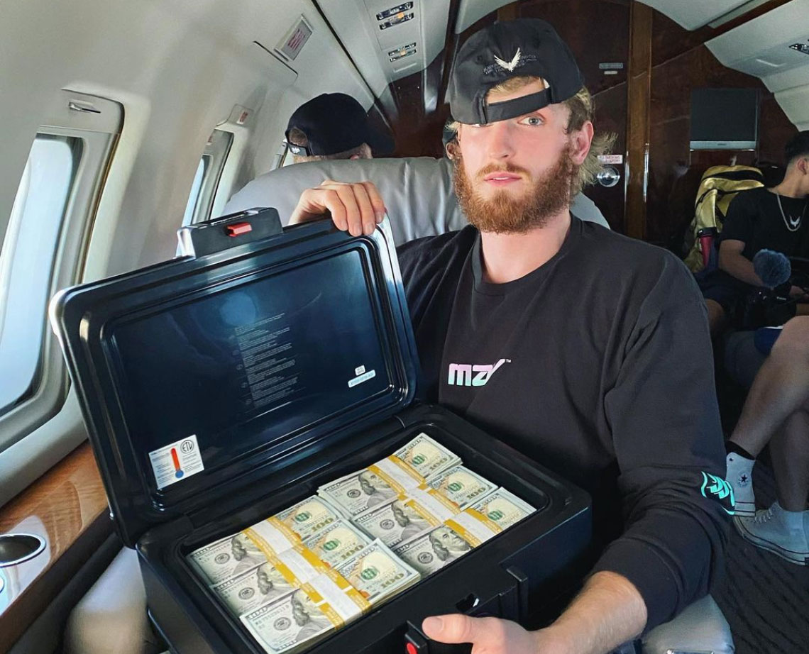 logan paul with suitcase of money