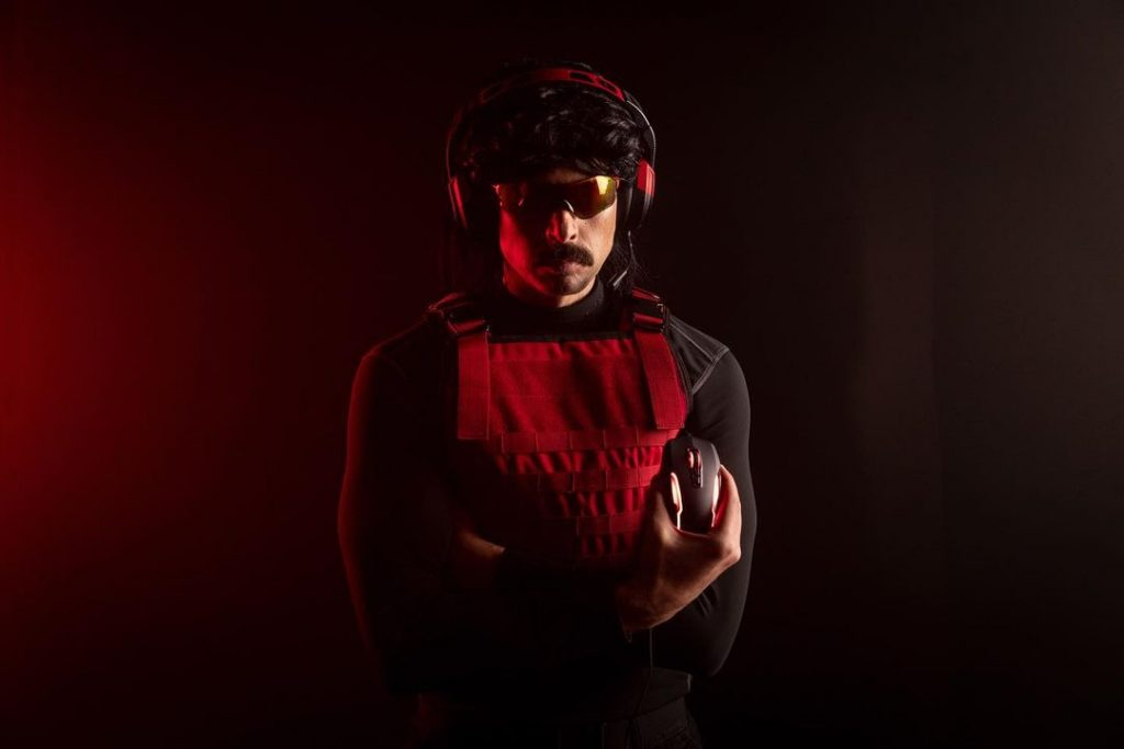 Dr Disrespect holding gaming mouse